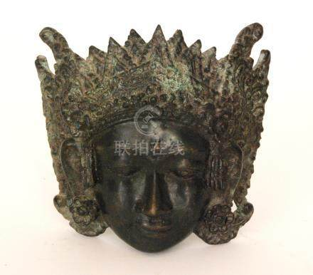 A late 19th to early 20th Century bronze Tibetan Buddhist deity mask, possibly Vasudhara,