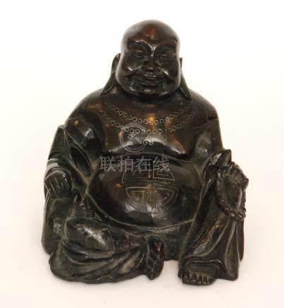 A small carved wooden buddha in the seated position height 13cm