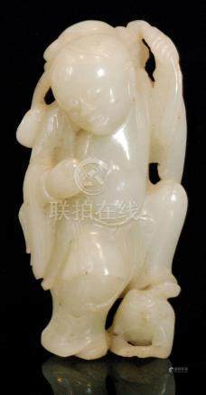 A late 19th and early 20th Century Chinese republic period carved jade figure of a monk with left
