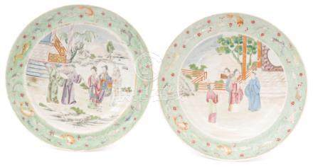 A pair of late 19th Century Chinese shallow dishes each decorated in enamels,
