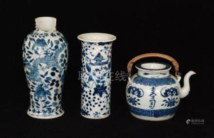 A late 19th to early 20th Century Chinese cylinder vase decorated in blue and white with two