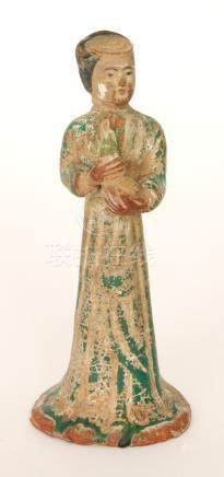A Tang dynasty style terracotta or red clay figure modelled as a standing woman attendant,