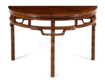 * A Chinese Hardwood 'Bamboo-Motif' Demi-Lune Console