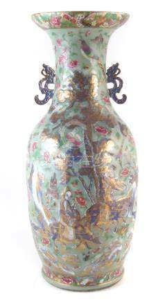 Large Chinese famille rose twin handled vase, with figures in landscapes painted in blue on raised