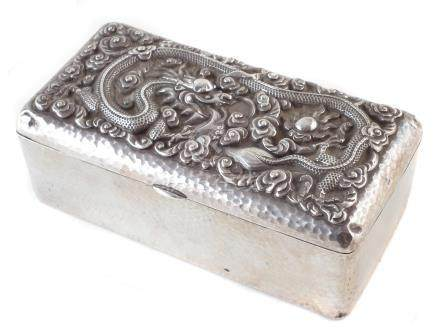 Chinese silver Canton cigarette box, embossed with a dragon, 15.5cm wide For a condition report on