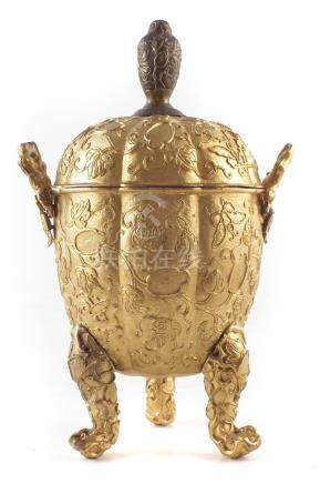 Chinese gilt copper lidded box , the lobed melon shape body worked in medium relief on a stippled
