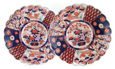 Pair of Japanese chargers , painted with vases of flowers in an Imari palette, Meiji period, late