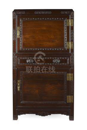 HARDWOOD SIDE CABINETEARLY 20TH CENTURY the moulded rectangular top above a geometric carved front