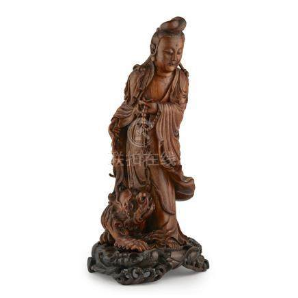 CARVED BOXWOOD FIGURE OF GUANYINLATE QING DYNASTY/REPUBLIC PERIOD elegantly coiffed and dressed in