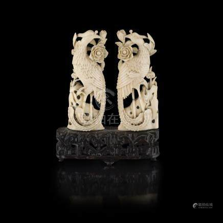 PAIR OF CARVED IVORY PHOENIXQING DYNASTY, 19TH CENTURY each of flattened shape, shown perched on