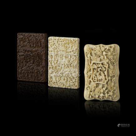 TWO CANTON IVORY CARD CASES AND A SANDALWOOD CARD CASEQING DYNASTY, 19TH CENTURY carved in deep