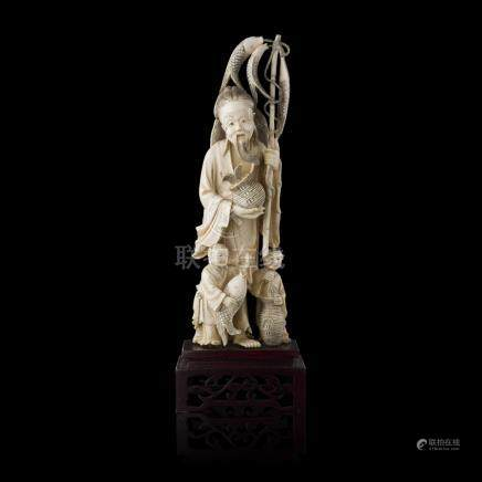 IVORY FIGURAL GROUP OF A FISHERMAN AND TWO BOYSLATE QING DYNASTY the elderly man shown holding his