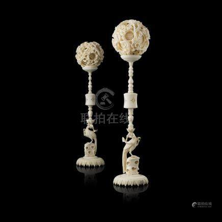 TWO CANTON IVORY PUZZLE BALLS AND STANDSREPUBLIC PERIOD each stand carved with a phoenix perched