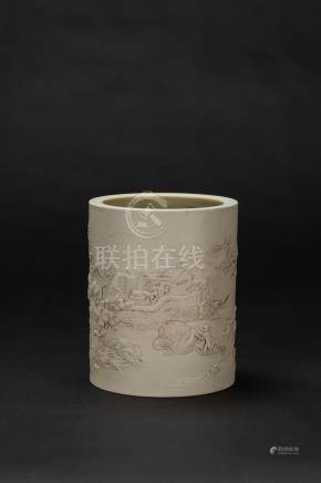 A Porcelain Brush Holder Carved Land scape and Figures