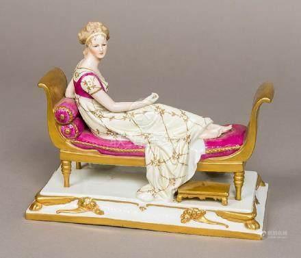 A GDR porcelain figure of Madame Recamier, possibly