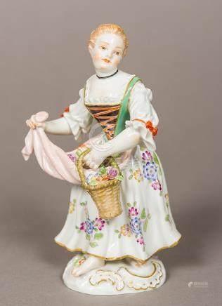 A Meissen porcelain figurine Modelled as a flower girl,