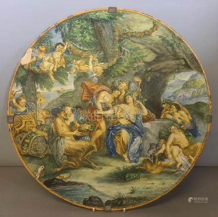 An antique Cantagalli charger Decorated with cherubs