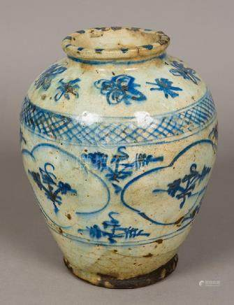 An antique Persian blue and white pottery vase