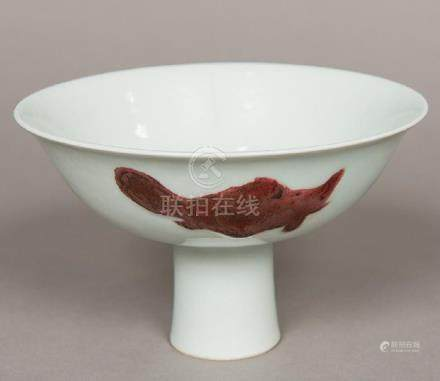 A Chinese porcelain stem cup The bowl decorated in iron