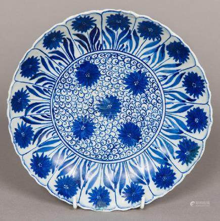 A Chinese blue and white porcelain dished plate Worked