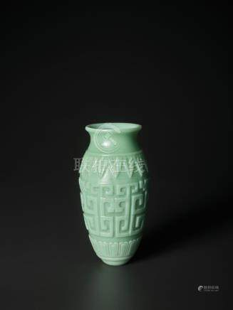 A RARE CARVED ARCHAISTIC 'KUILONG' TURQUOISE GLASS VASE, MID