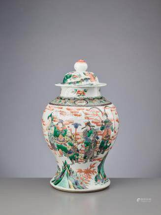 A LIDDED QING DYNASTY FAMILLE VERTE BALUSTER JAR 'EIGHT IMMO