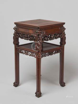 A FINELY CARVED SQUARE WOODEN TWO-STOREY HIGH TABLE, QING DY