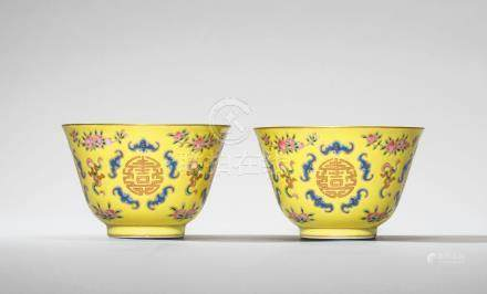 A PAIR OF YELLOW-GROUND FAMILLE ROSE 'PEACH AND SHOU' CUPS