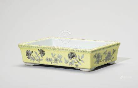 A YELLOW-GROUND GRISAILLEDECORATED 'FLOWERS OF FOUR SEASONS' JARDINIERE STAND
