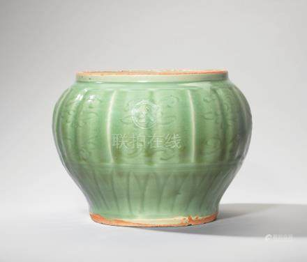 A RARE LONGQUAN CELADON CARVED AND MOULDED 'SEA CREATURE' JAR