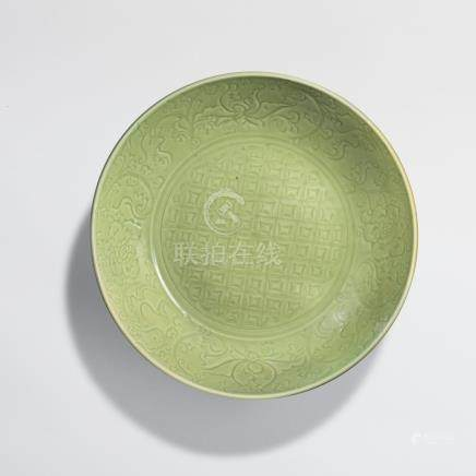 A LARGE LONGQUAN CELADON INCISED CHARGER