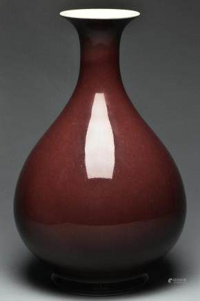A QING DYNASTY RED GLAZED VASE QIANLONG MARK