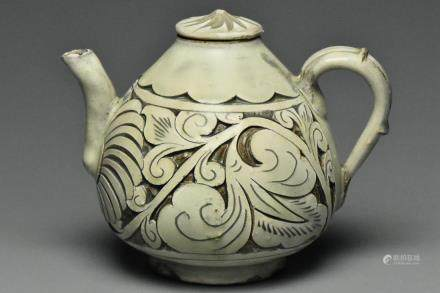 A SONG DYNASTY CIZHOU SGRAFFIATO TEAPOT AND COVER
