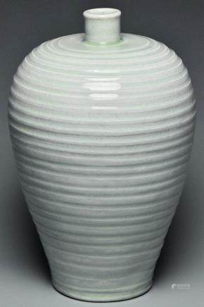 A SONG DYNASTY CARVED QINGBAI MEIPING VASE