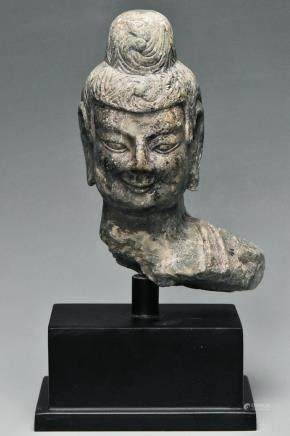 A NORTHERN WEI DYNASTY LIMESTONE HEAD OF BUDDHA