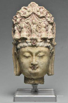 A TANG DYNASTY LIMESTONE HEAD OF BUDDHA AND STAND