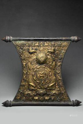 A MING DYNASTY GILT COPPER REPOUSSE PLAQUE