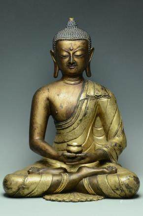 A LARGE MING DYNASTY GILT BRONZE FIGURE OF BUDDHA
