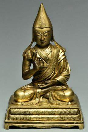 A SINO-TIBETAN GILT BRONZE FIGURE OF TSONGKAPA