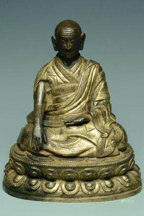 INSCRIBED TIBETAN QING DYNASTY GILT BRONZE LAMA