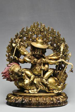 A SINO-TIBETAN GILT BRONZE FIGURE OF MAHAKALA