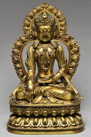 A MING GILT BRONZE GUANYIN YONGLE MARK AND PERIOD