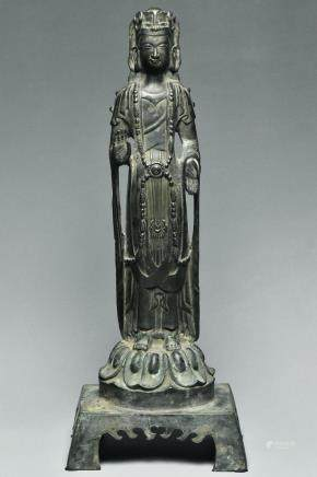 A TANG DYNASTY SILVER FIGURE OF GUANYIN