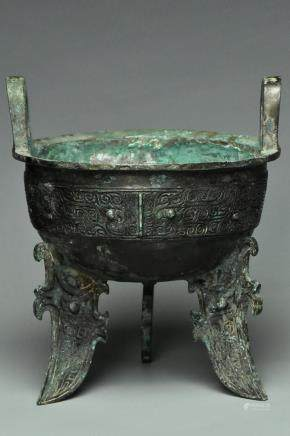 A SHANG DYNASTY INSCRIBED BRONZE RITUAL DING