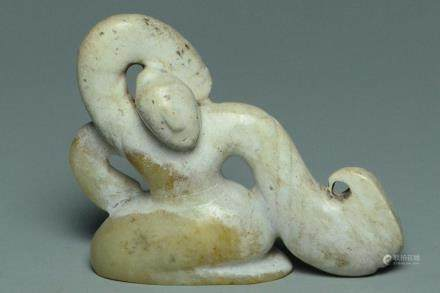 A HAN DYNASTY CALCIFIED JADE FIGURE OF A DANCER