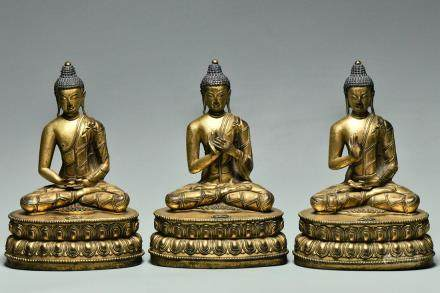 SET OF THREE GILT BRONZE FIGURES OF BUDDHA 15TH C