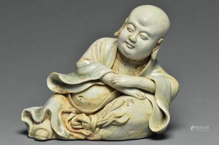 A YUAN DYNASTY QINGBAI FIGURE OF BUDAI