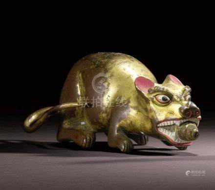 A PAIR OF GILT COPPER ALLOY MONGOOSES TIBET, 19TH/20TH CENTURY