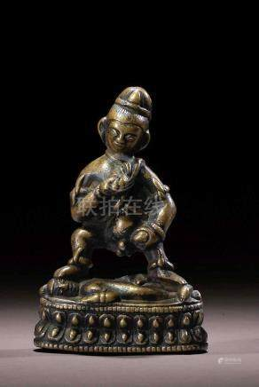 A SILVER INLAID COPPER ALLOY FIGURE OF KALAJAMBHALA TIBET, 12TH CENTURY