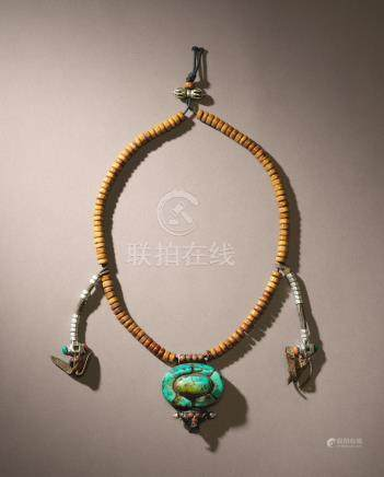 A BONE MALA WITH TURQUOISE INLAID SILVER GAU